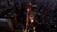 Aerial wide shot pan up Broadway to Times Square at night/ New York City