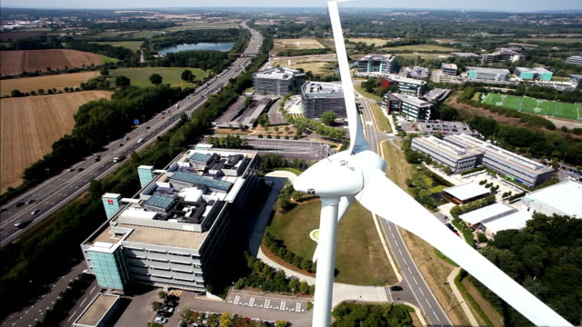 Aerial wind turbine by busy highway