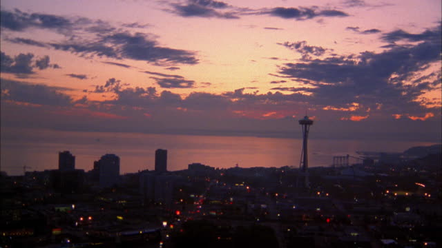 Aerial zoom in Space Needle at dusk / Seattle
