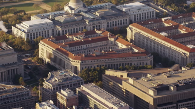 Aerial zoom out from Department of Justice to Washington DC daytime
