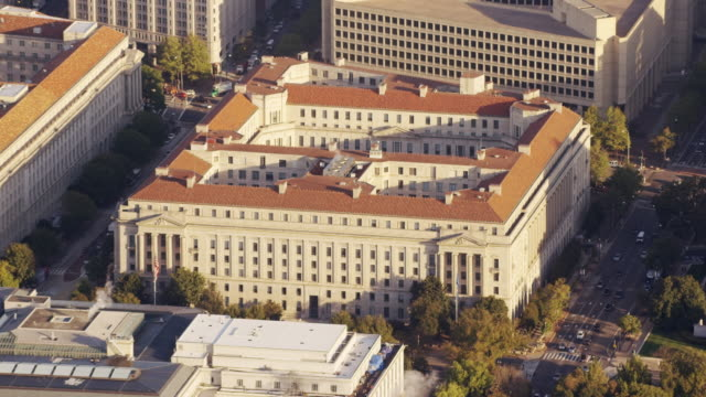 Aerial zoom out from Department of Justice to wide of Washington DC daytime