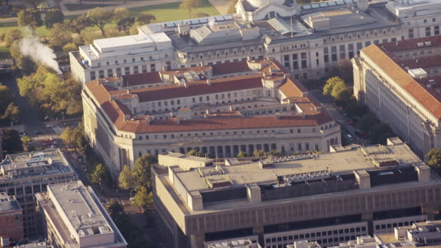 Aerial zoom out from Department of Justice, Washington DC daytime