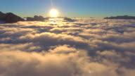 Aerial:Above the clouds with Golden sunrise
