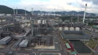AERIAL:oil refinery facilities with tanker