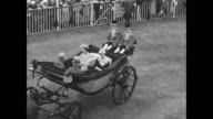 Aerials Ascot Racecourse as the royal family arrives in open horsedrawn carriages / Queen Elizabeth II with Prince Philip Duke of Edinburgh and...