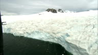 Coast / mountains / ice floes Tracking sequence of craggy pale browntinged ice sheet facing out to sea full of crevasses