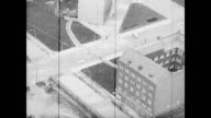 / aerials of Berlin streets and buildings / left over bombing damage is can be seen on some buildings / aerial of Reichstag Berlin Wall aerials over...