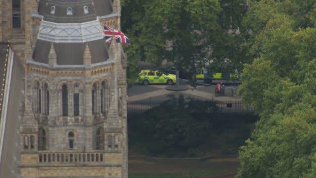 Aerials of car crash near Natural History Museum and City of London at sunset ENGLAND London Kensington VIEWS AERIALS police at scene of crash...