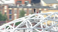 Aerials of free runner James Kingston on top of Wembley Stadium arch James Kingston is a freerunner who has ascended some of the world's tallest...