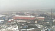 Aerials of snow in Merseyside Sellafield Carsethorn and Dumfries ENGLAND Merseyside Near Bootle EXT Snow falling over railway line / snow covered...