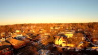 Aerials over a small New England town, afternoon, very clear cold day with golden light.