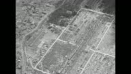 VS aerials over devastated city of Hiroshima mostly nothing standing after US atomic bombing during World War II / aerial over part of city with a...