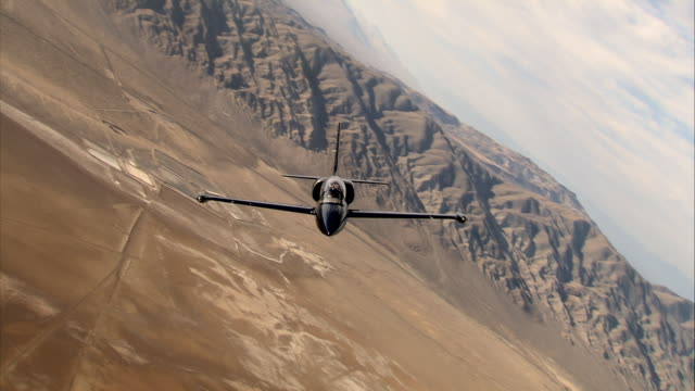 AIR TO AIR, CANTED, Aero L-39 Albatros flying over Mojave Desert, mountains in background, California, USA