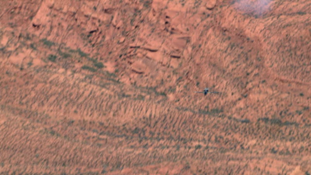 AIR TO AIR, Aero L-39 Albatros flying over rock formations, Grand Canyon, Arizona, USA