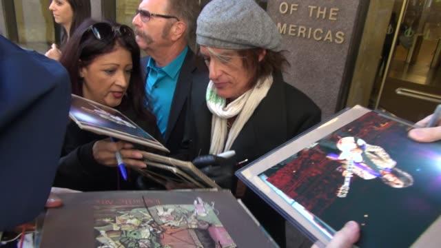 Aerosmith guitarist Joe Perry leaving SiriusXM Satellite Radio signs for fans in New York City at Celebrity Sightings in New York