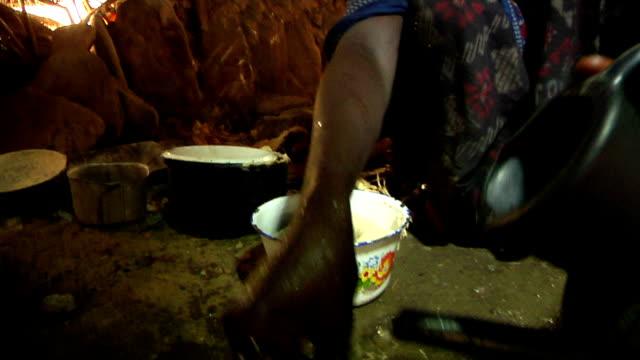 Afar woman preparing food on August 13 2011 in Afar villageDanakil depression Ethiopia