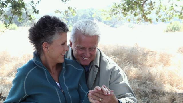 Affectionate mature couple outdoors