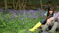 Affectionate young couple in field with bluebells
