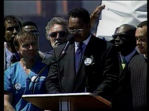 Affirmative action ITN Marchers opposing ending of affirmative action crossing Golden Gate bridge Black man amongst marchers Rev Jesse Jackson...