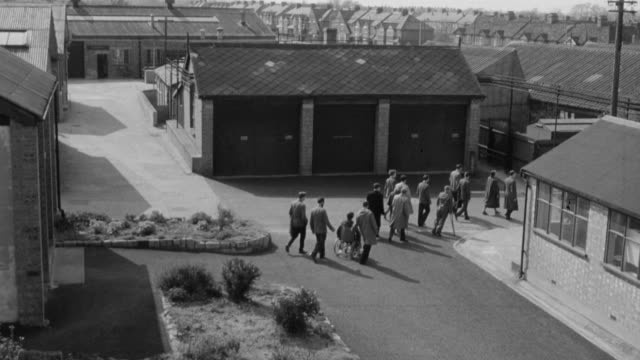MONTAGE Afflicted and disabled workers entering building / England, United Kingdom