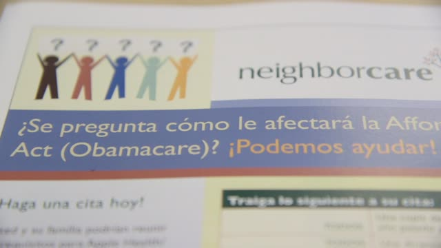 'Affordable Care Act' and 'Obamacare' written in English on Spanish language healthcare brochure