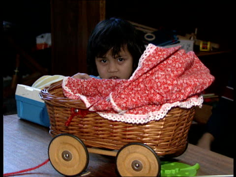 Afghan children injured in war AFGHANISTAN Kabul INT Benasha little girl who lost her legs sitting on bed CU stumps Benasha laughing and chatting...