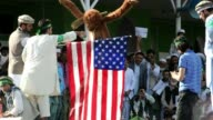 Afghan demonstrators burn effigy of US President Obama and US flag during antiIslam movie protest VOICED Afghans protest on September 21 2012 in...