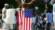 Afghan demonstrators burn effigy of US President Obama and US flag during antiIslam movie protest VOICED Afghans protest on September 21 2012 in...