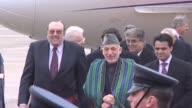 Afghan Hamid Karzai arrives in London for talks on Afghanistanwalks through RAF guard of honour