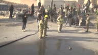 Afghan security forces try to lift a damaged vehicle after the suicide attack in Kabul Afghanistan on December 2014 A suicide bomber targeted a bus...