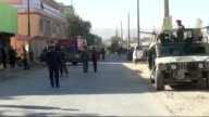 Afghan security officials inspect the site of a bomb blast that targeted army buses in Kabul Afghanistan on October 2 At least 3 killed and 7 wounded...