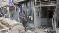 Afghan security officials inspect the site of a suicide attack on August 29 2017in Kabul Afghanistan A suicide attack in downtown Kabul aimed at the...
