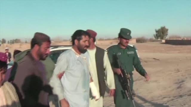Afghanistan rushed military reinforcements to Helmand Wednesday after the Taliban captured large swathes of a strategic opium producing district...