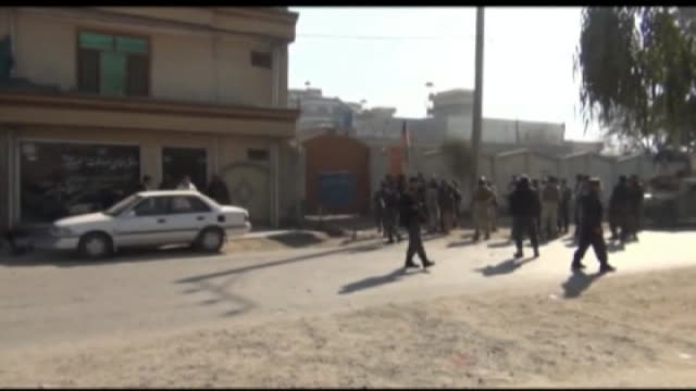 Afghans gather after a suicide bomber killed 13 people in the eastern Afghan city of Jalalabad at the home of a tribal elder when people had gathered...