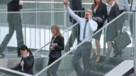 DS African American business man doing happy dance on stairs
