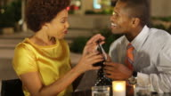 African American couple in cafe with gift