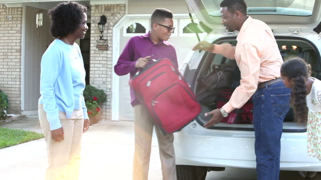 African American family going on vacation or road trip