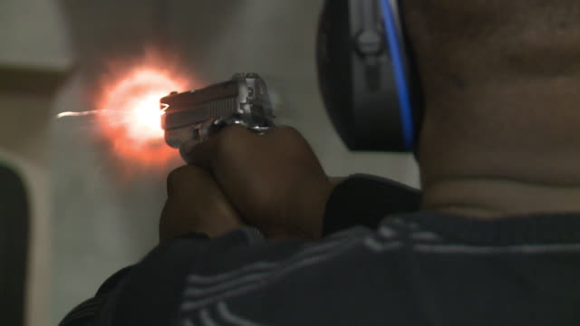 African American Man Fires Handgun and Loads Clip at Maryland Small Arms Range on January 20 2013 in Upper Marlboro Maryland