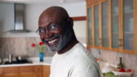 African American man smiling in domestic kitchen
