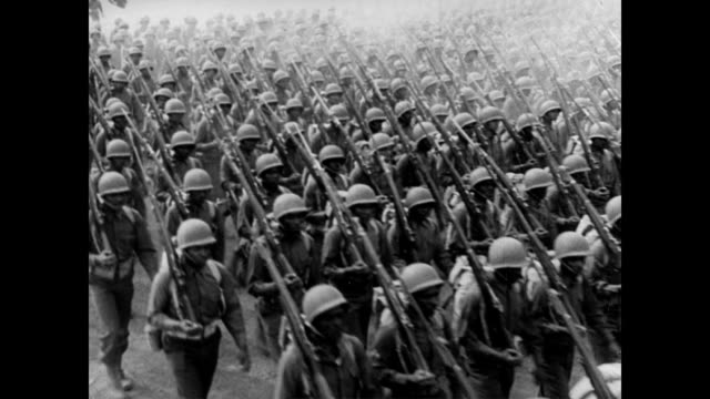 African American soldiers marching down the street / huge amount of African American men and women march military time across view / split screen...