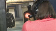 African American Woman Fires a Handgun at a Target at Maryland Small Arms Range on January 20 2013 in Upper Marlboro Maryland