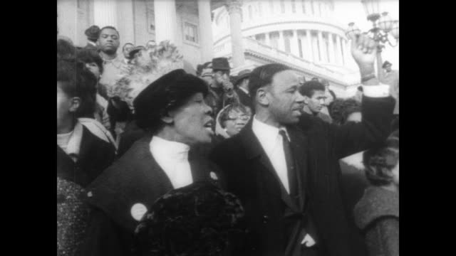 African Americans line the steps of Capitol Hill protesting the vote to exclude Harlem Democrat Adam Clayton Powell after allegations of corruption /...