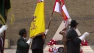 African and Caribbean war memorial unveiled in London ENGLAND London EXT **Music heard intermittently SOT** People Veterans marching with flags as...