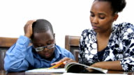 African descent mother reading with son