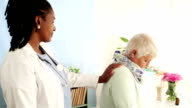 African doctor supporting senior patient in quiet moment