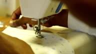 CU African ethnicity child sewing garment in sewing class/ KwaZulu-Natal/ South Africa