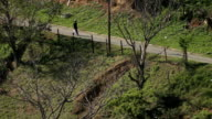 HA SLO MO African ethnicity male walking down road with dog in rural township/ KwaZulu-Natal/ South Africa