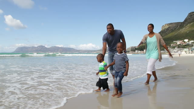 African family taking a walk on the beach