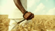 HD SLOW-MOTION: African Man Blessing In Wheat
