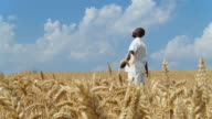 HD DOLLY: African Man In A Wheat Field